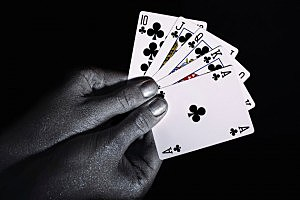 Playing cards in the silver male hands