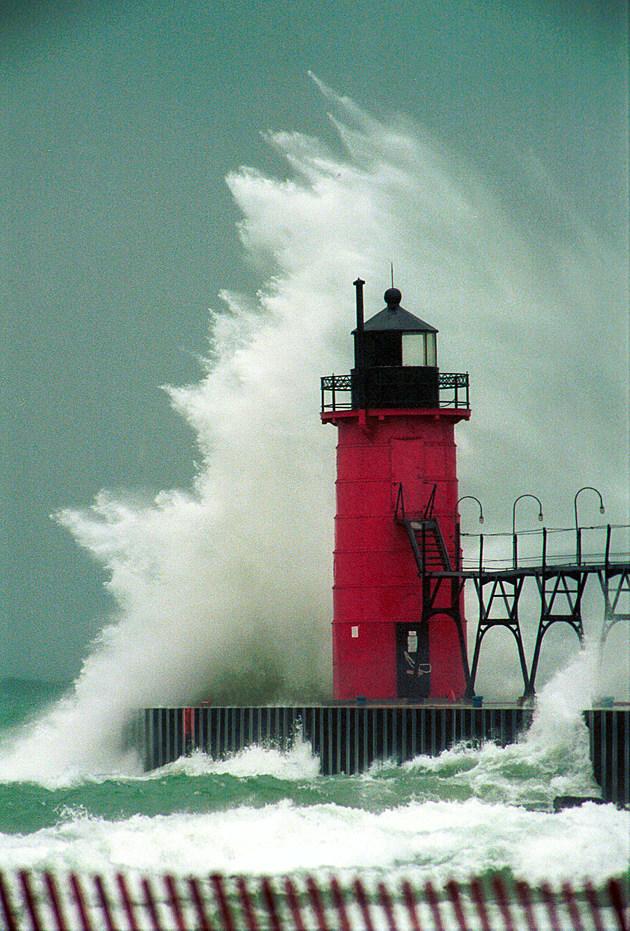 Waves Crash Over Lighthouse on Lake Michigan