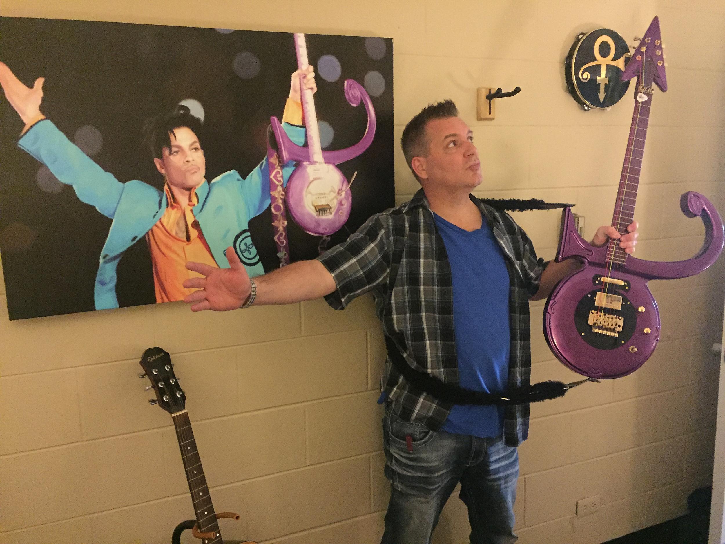Prince recovers like a boss dana marshall with his purple prince symbol guitar buycottarizona
