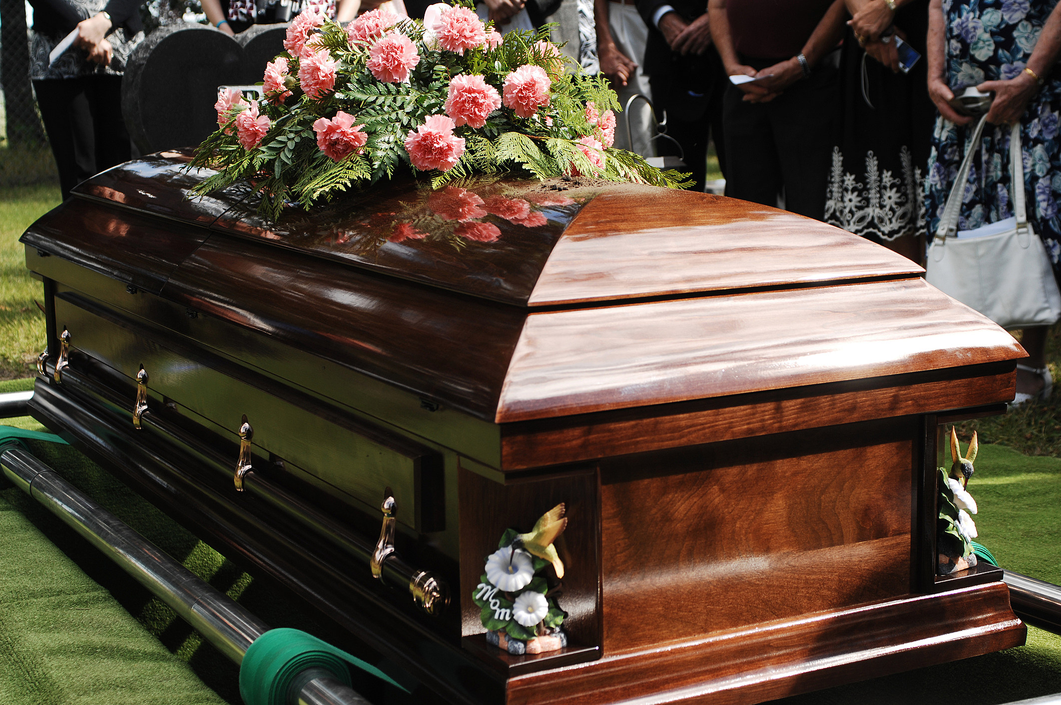 Coffin at a funeral service in a cemetery